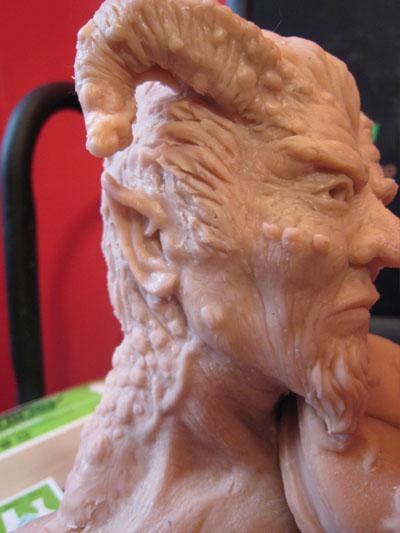 sculpting an ear in polymer clay